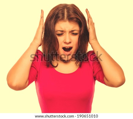 brunette woman covering her ears with her hands screaming opened her mouth isolated large cross processing retro - stock photo