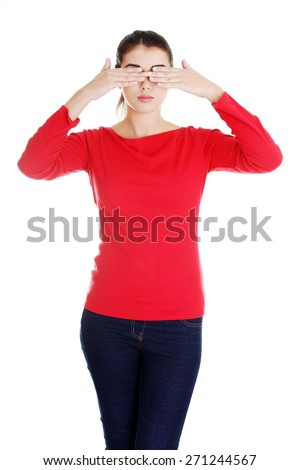 Brunette woman covering her face with both hands.