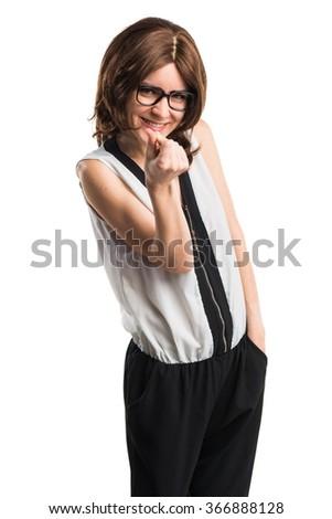Brunette woman doing a money gesture - stock photo