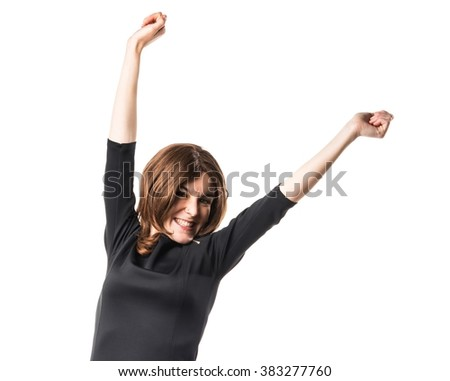 Brunette woman doing victory gesture