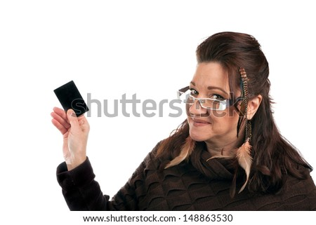 Brunette woman holding up a blank credit card business card shoppers club card or gift card of some sort with copyspace.  - stock photo