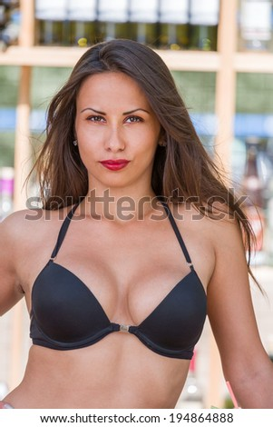 Brunette Woman in bikini at the summer beach bar - stock photo