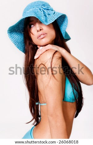 brunette woman in blue bikini and hat - stock photo