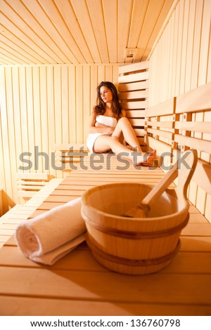 Brunette Woman In Sauna. - stock photo