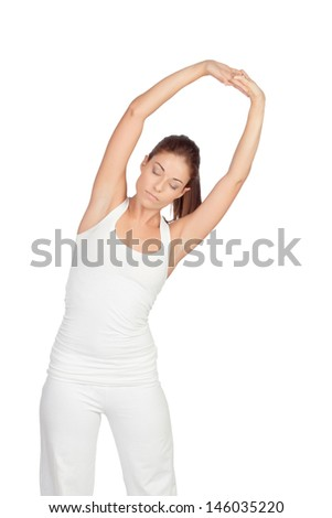 Brunette woman in white doing stretching isolated