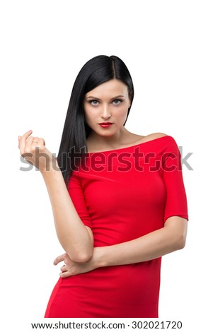 Brunette woman is in a red dress. Isolated background. - stock photo