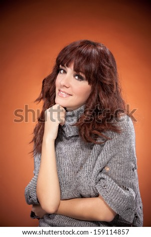 Brunette woman is looking towards the camera