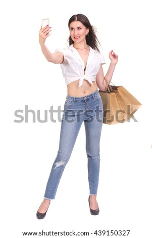 Brunette woman making selfie with shopping bags