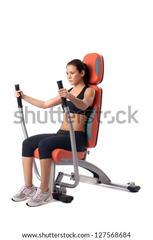 Brunette woman on hydraulic exerciser