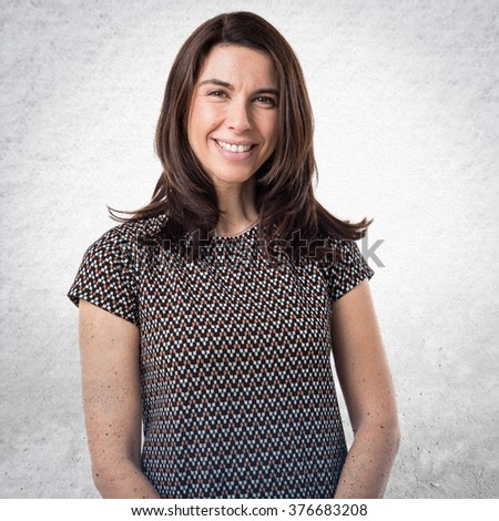 Brunette woman over textured background - stock photo