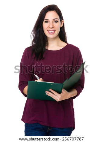 Brunette woman take note on clipboard