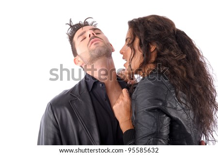 Brunette woman trying to bite a man neck vampire style - stock photo