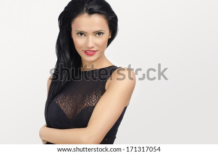 Brunette woman with big breast and red lips posing sexy - stock photo