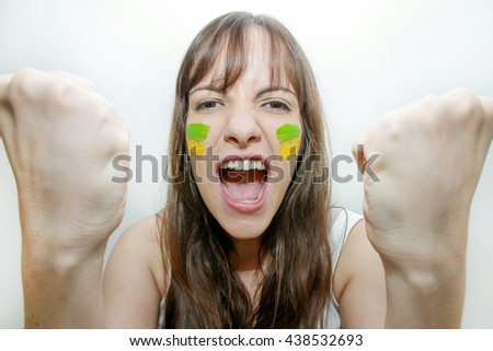 brunette woman with black eyes cheering for brazil soccer olympics