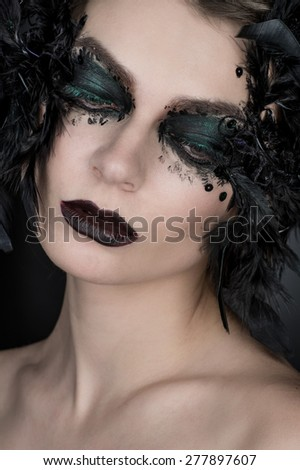 Brunette woman with creative make-up