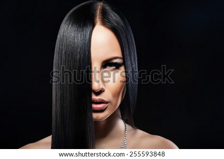 Brunette woman with healthy long hair - stock photo