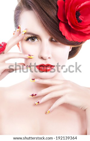 Brunette woman with poppy flower in her hair, poppy ring and creative nails on white background - stock photo