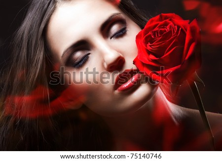 brunette woman with red rose - stock photo