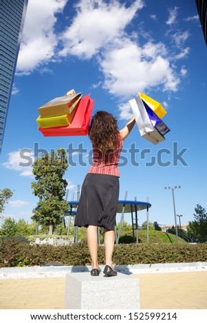 brunette woman with shopping bags walking in Madrid city Spain - stock photo