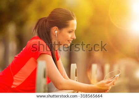 Brunette young woman listening to music. - stock photo