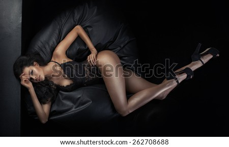 Brunette young woman with a shining skin - stock photo
