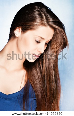 brunette young woman with long healthy hair, studio shot - stock photo