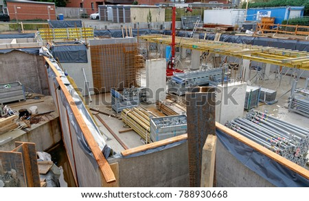 Brunswick, Lower Saxony, Germany, January 6,2018: Construction site of the basement for the construction of a new house for many families in a suburb of Germany.