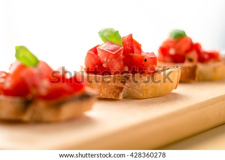 Bruschetta is an italian food made of chopped tomatoes, garlic, basil and fresh herbs on a toasted bread. These are traditionally served as snacks or antipasti (appetizers).