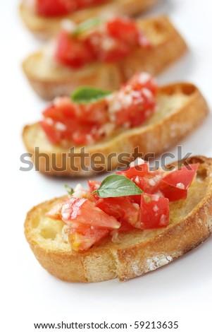 Bruschetta( Italian Toasted Garlic Bread ) with tomato - stock photo