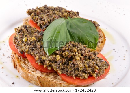 Bruschetta with capers, olives and tomatoes - stock photo