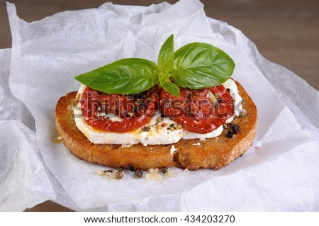 Bruschetta with feta and sun-dried tomatoes slices spiced - stock photo
