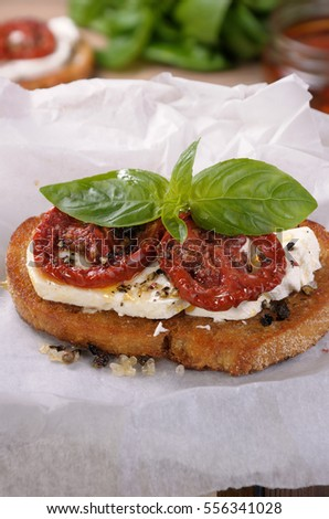 Bruschetta with feta and sun-dried tomatoes slices spiced