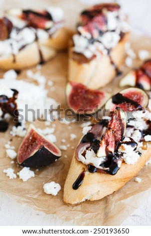 Bruschetta with figs,goat cheese and balsamic sauce.selective focus - stock photo