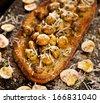 Bruschetta with fried mushrooms, garlic, parsley and Grana Padano cheese - stock