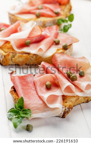 Bruschetta with ham and capers