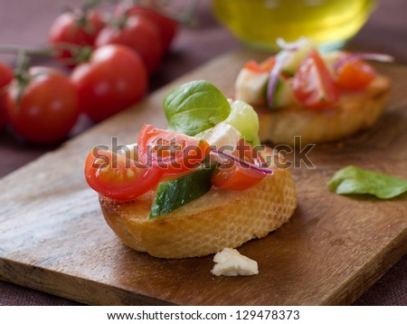 Bruschetta with juicy vegetables, selective focus