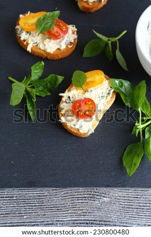 Bruschetta with mayonnaise and basil, food close-up - stock photo