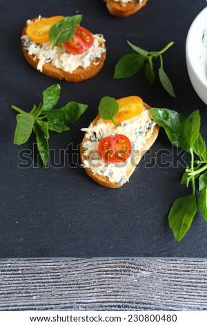 Bruschetta with mayonnaise and basil, food close-up - stock photo