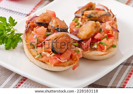 Bruschetta with mussels, cheese and tomatoes