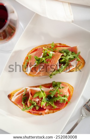 Bruschetta with Parma Ham and Parmesan Cheese - stock photo