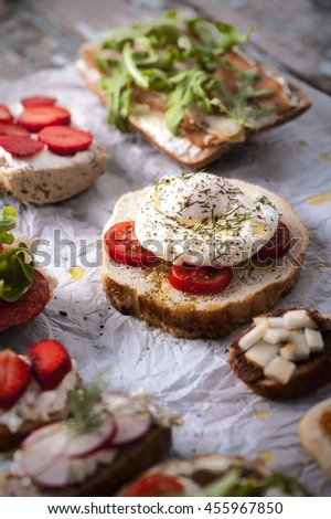 Bruschetta with poached egg - stock photo