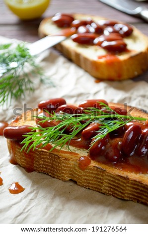 Bruschetta with red haricot bean, tomato sauce and dill