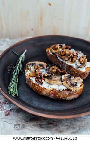 bruschetta with ricotta and mushrooms - stock photo