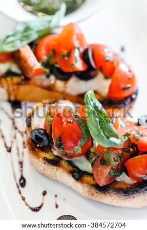 bruschetta with tomato - stock photo