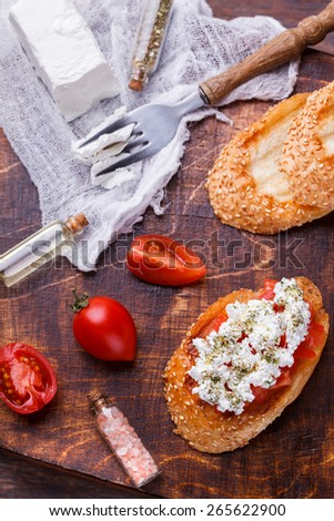 Bruschetta with tomato and feta cheese. selective focus - stock photo