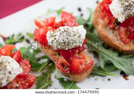 Bruschetta with tomato, basil, oregano, ricotta, and extra virgin olive oil