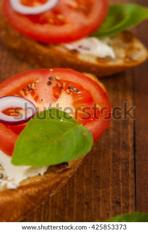 Bruschetta with Tomato, Cream Cheese and Basil. Selective focus.