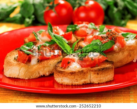 Bruschetta with tomatoes and mozarella - stock photo