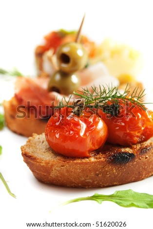 Bruschette, italian toasted bread with tomato and olives