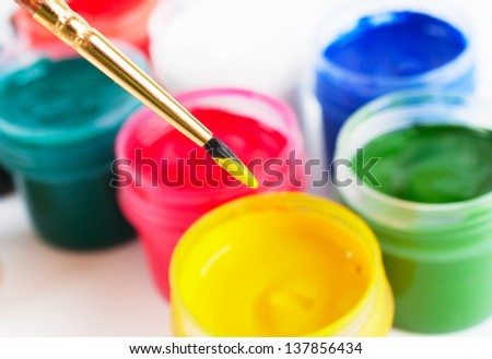 Brush and many paint jars with gouache - stock photo